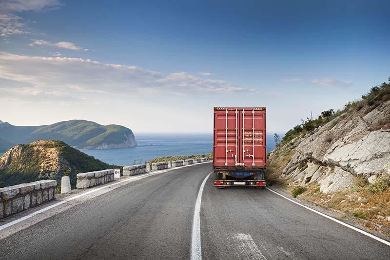 Semi hauling freight on mountain highway